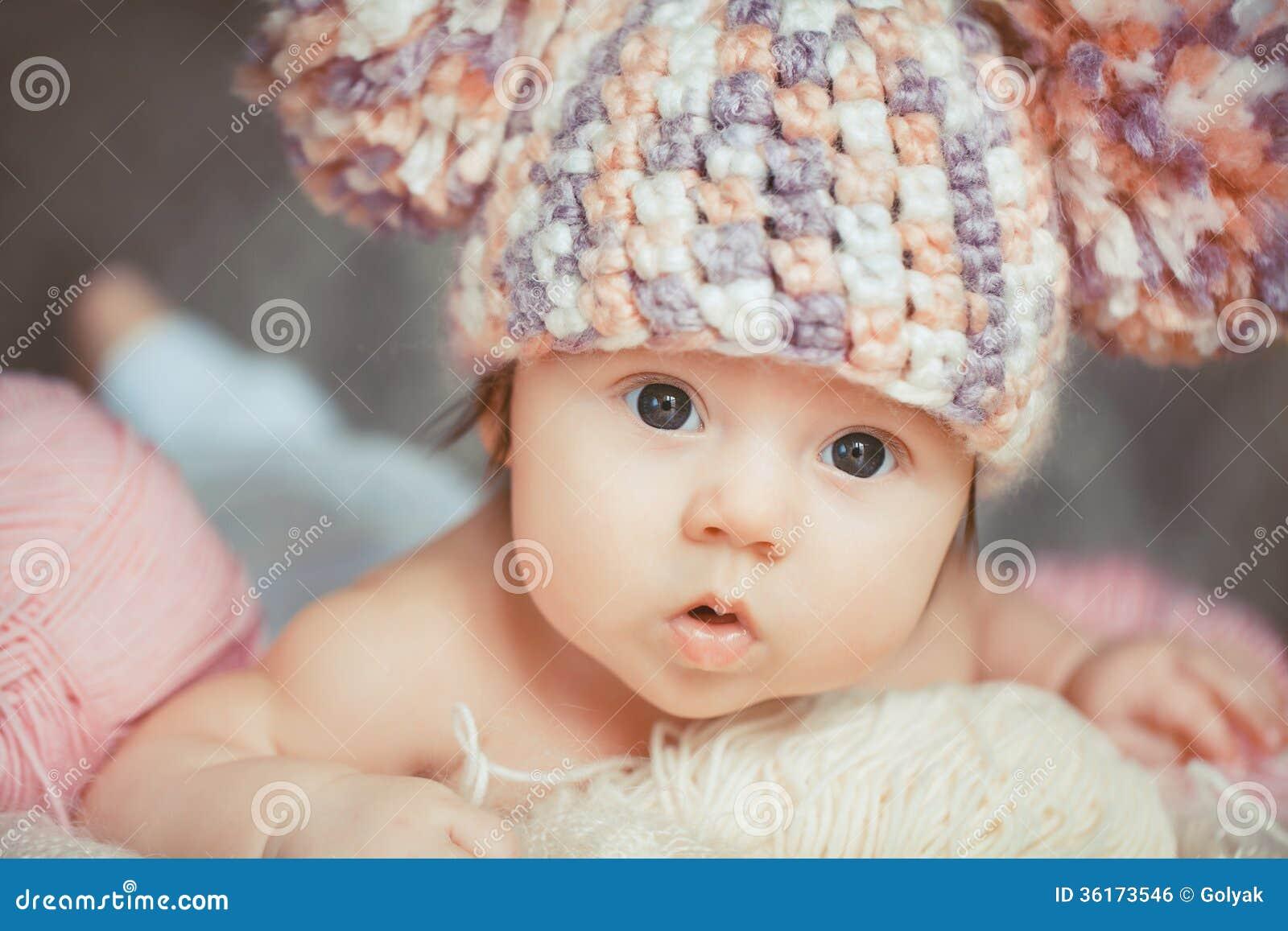 Adorable Smiling Newborn Baby Girl Lies In Basket Royalty