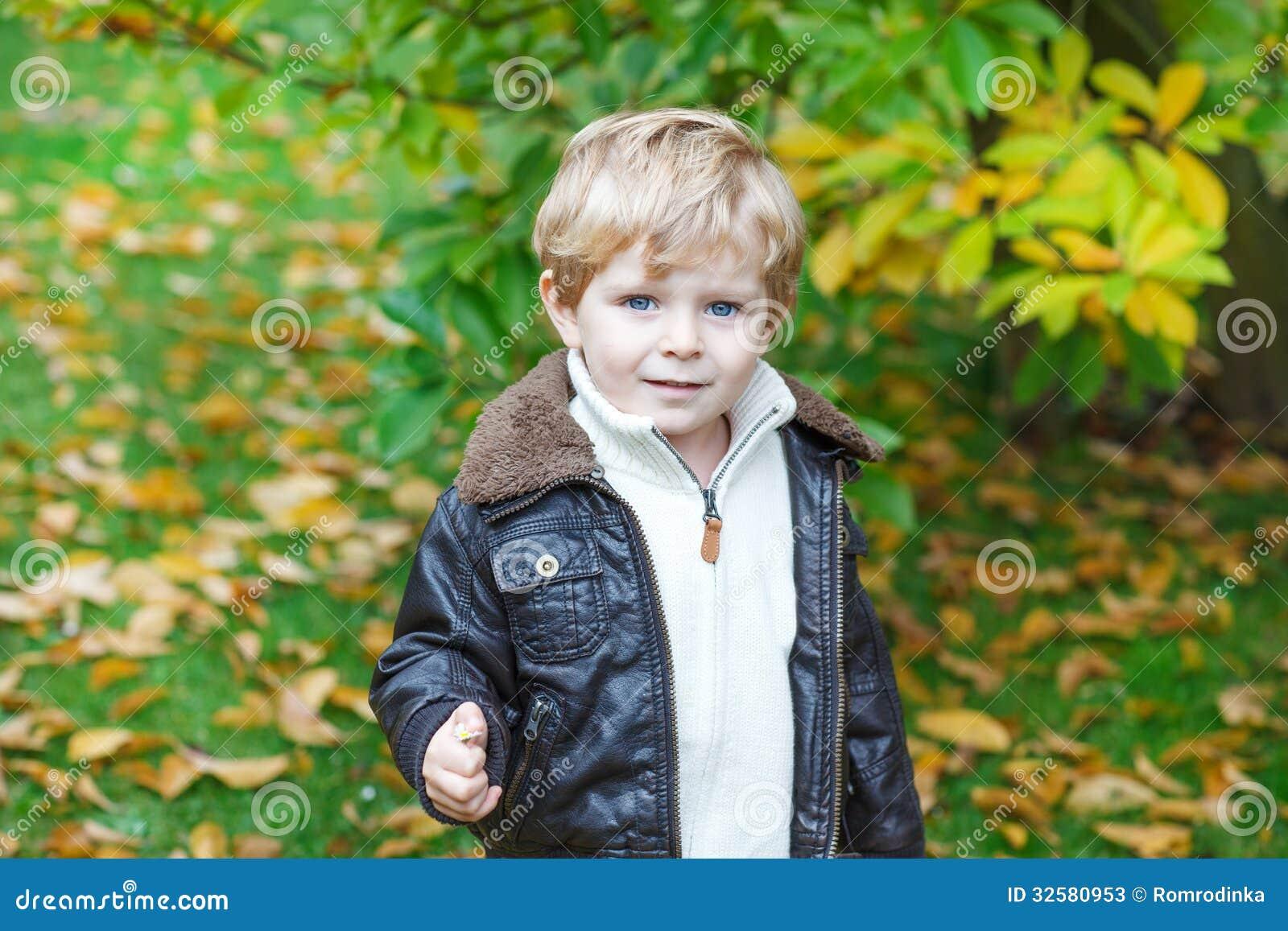 Adorable Toddler Boy In Autumn Park Stock Photos Image