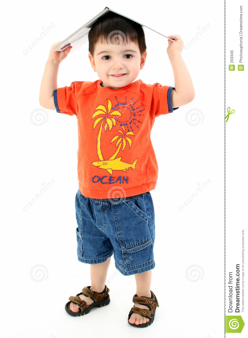 Adorable Toddler Boy With Book On Head