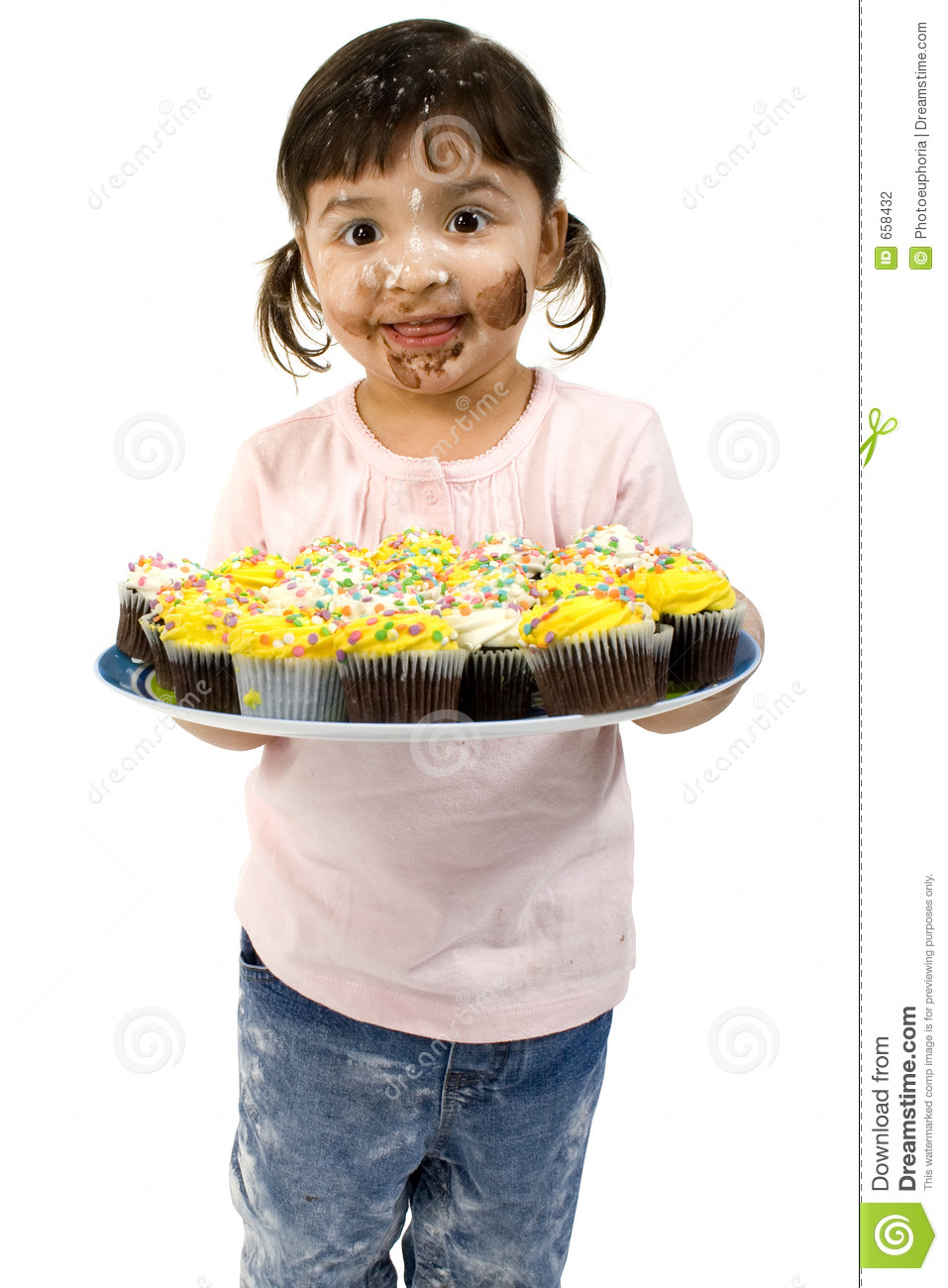Adorable Toddler Girl with Cupcakes