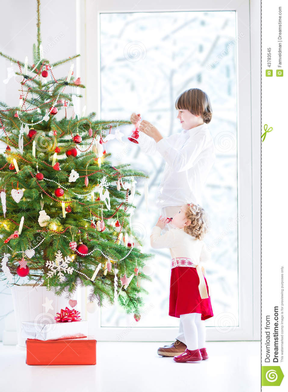 Adorable Toddler Girl Helping Her Brother To Decorate A Beautiful ...