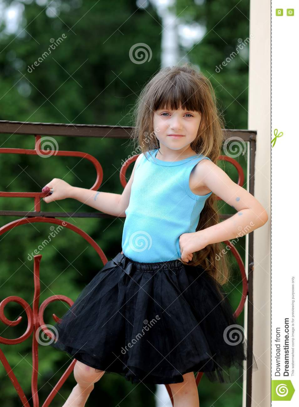 adorable toddler girl with very long dark hair stock image