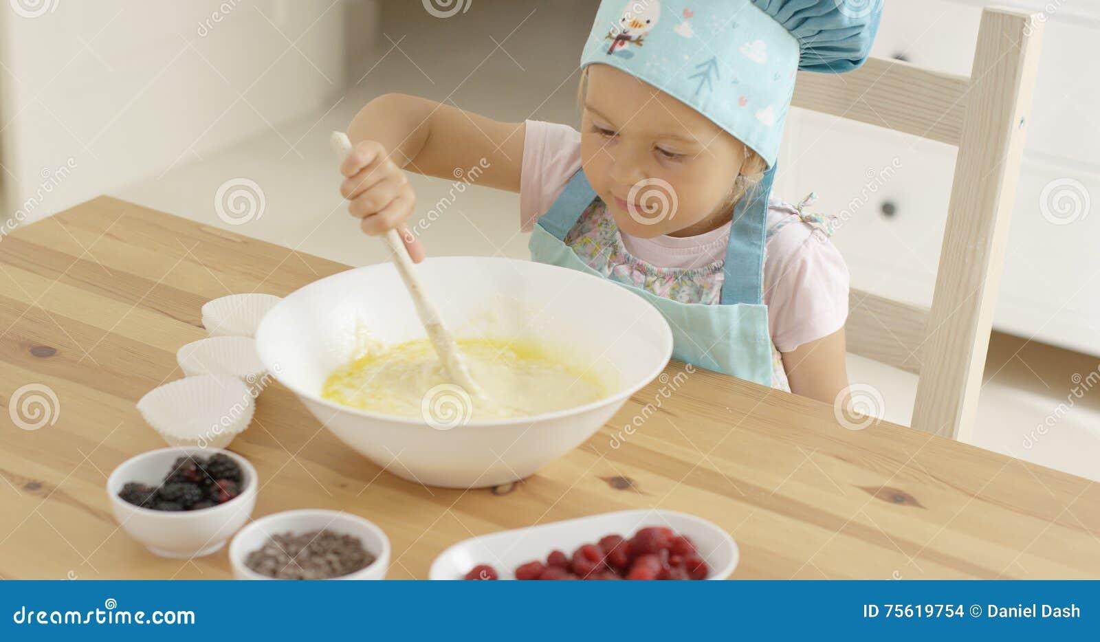 Adorable toddler at mixing bowl