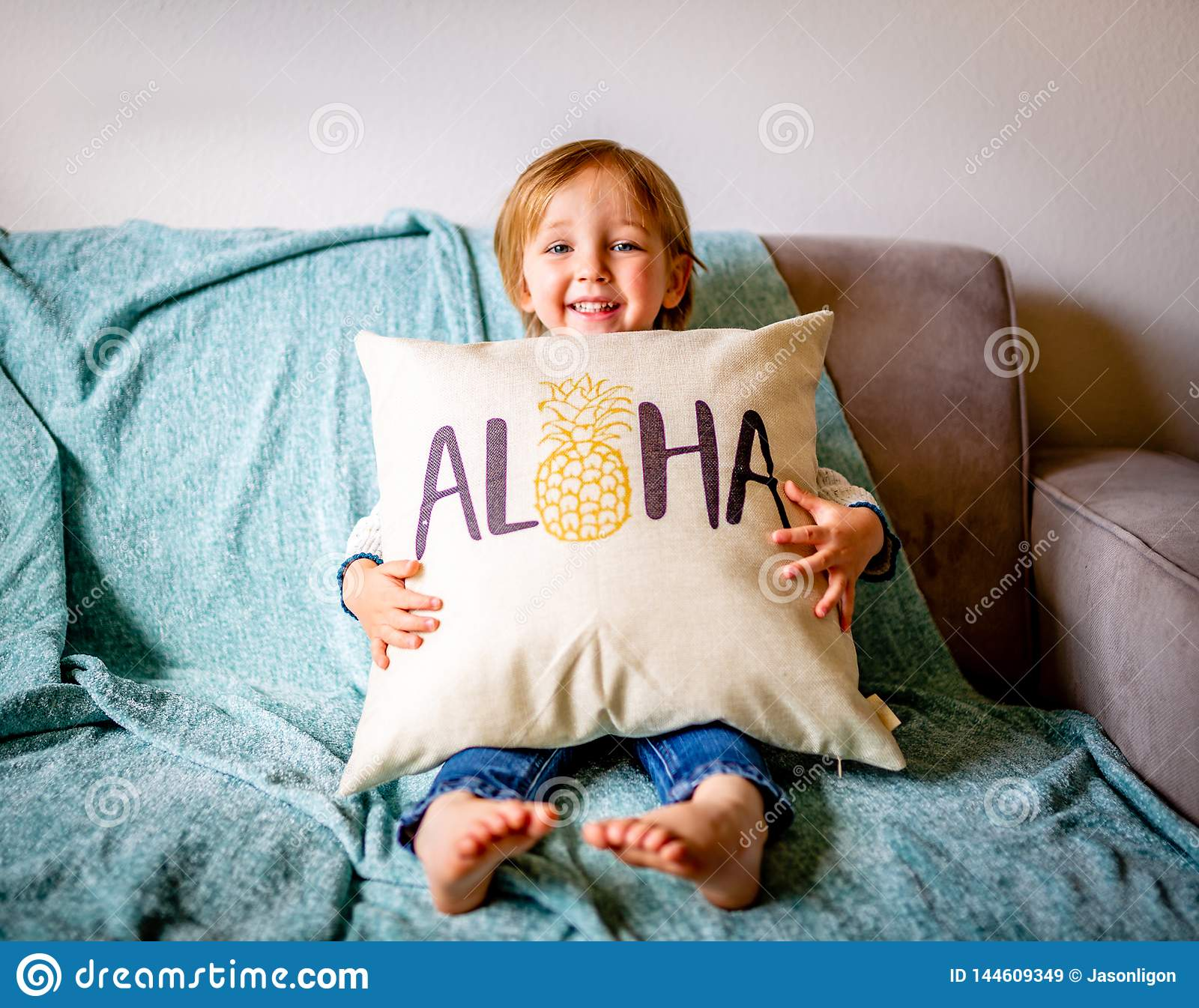 Young Boy Sits on Couch