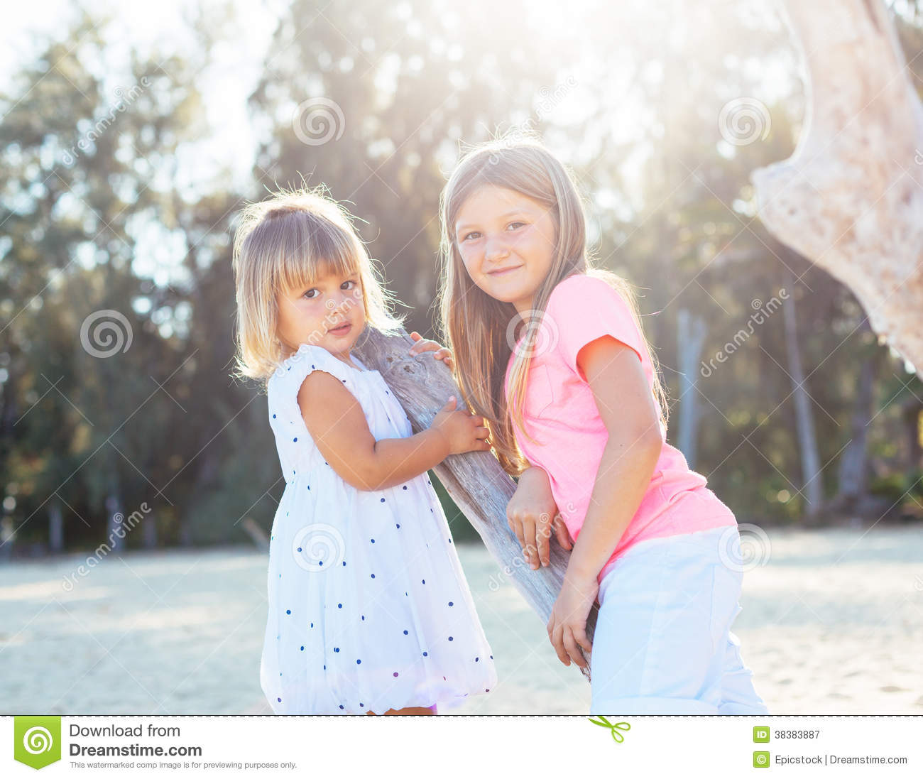 Adorable Little Girl Playing With Beach Toys During: Adorable Young Sisters At The Beach Stock Image