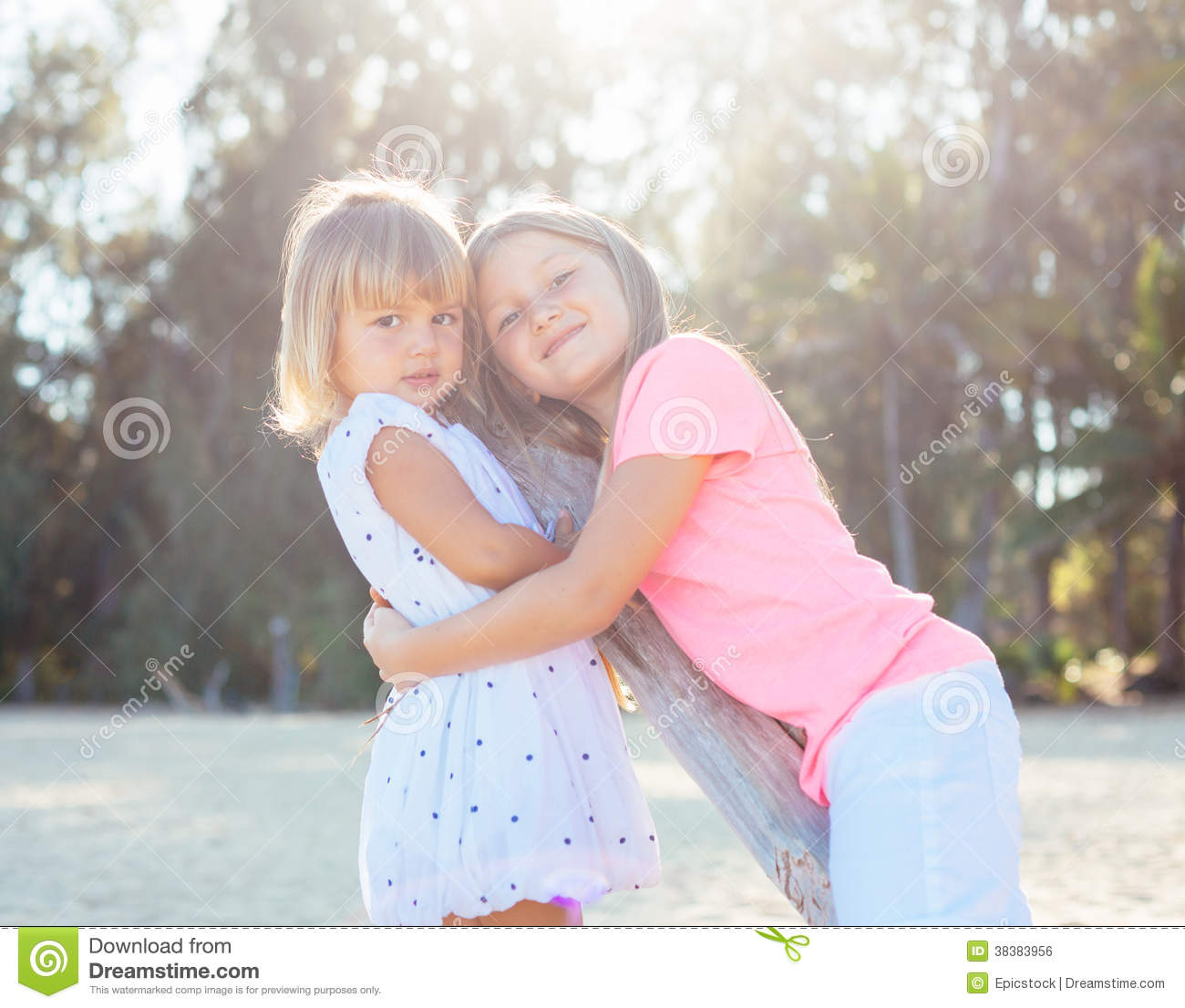 Young Happy Beautiful Family Playing Together On The Beach: Adorable Young Sisters Stock Photo. Image Of Cheerful