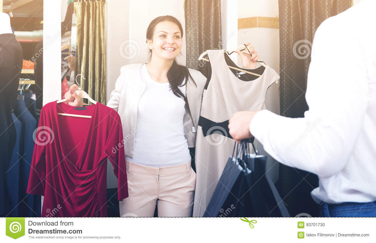 Adult Couple Purchasing Dress And Blouse Stock Photo