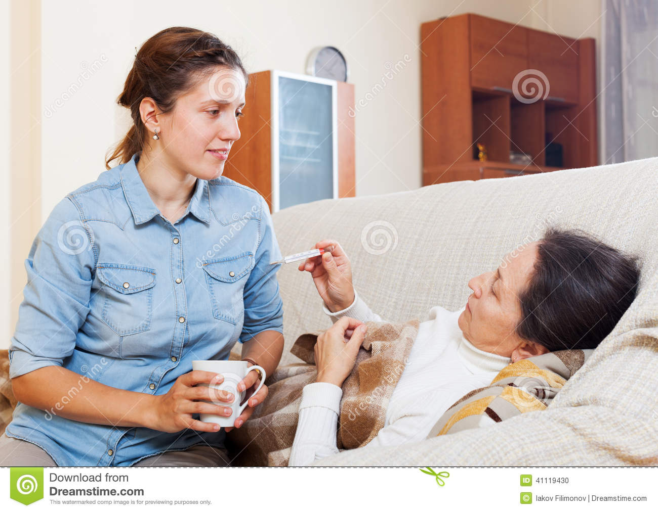 Adult daughter caring for sick mother