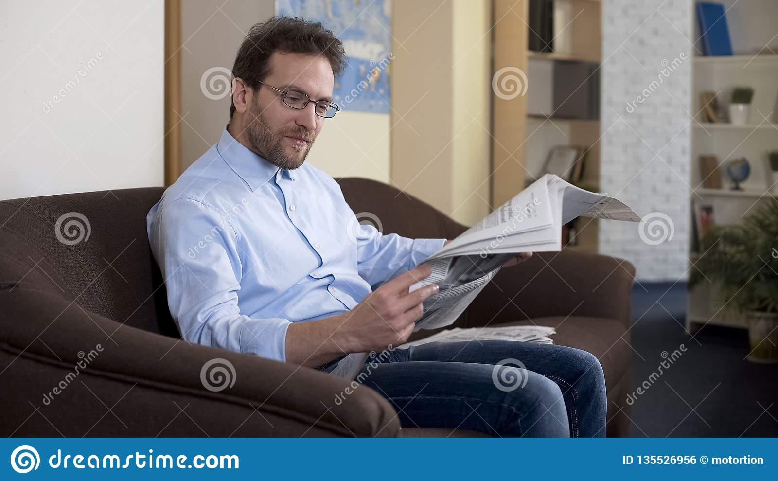 Adult male reading article in newspaper, freedom of speech, information