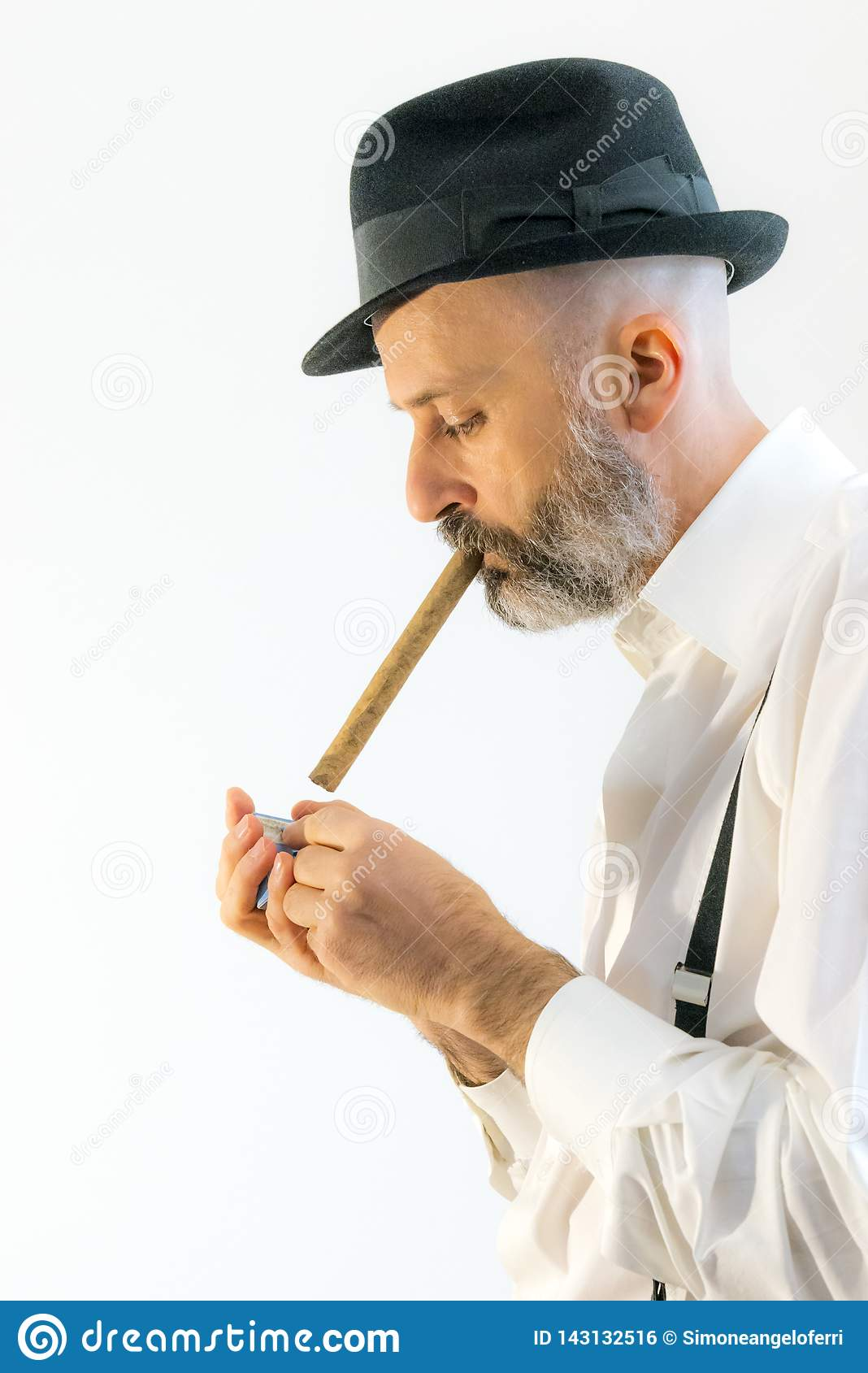 Adult man are smoking cigar with hat