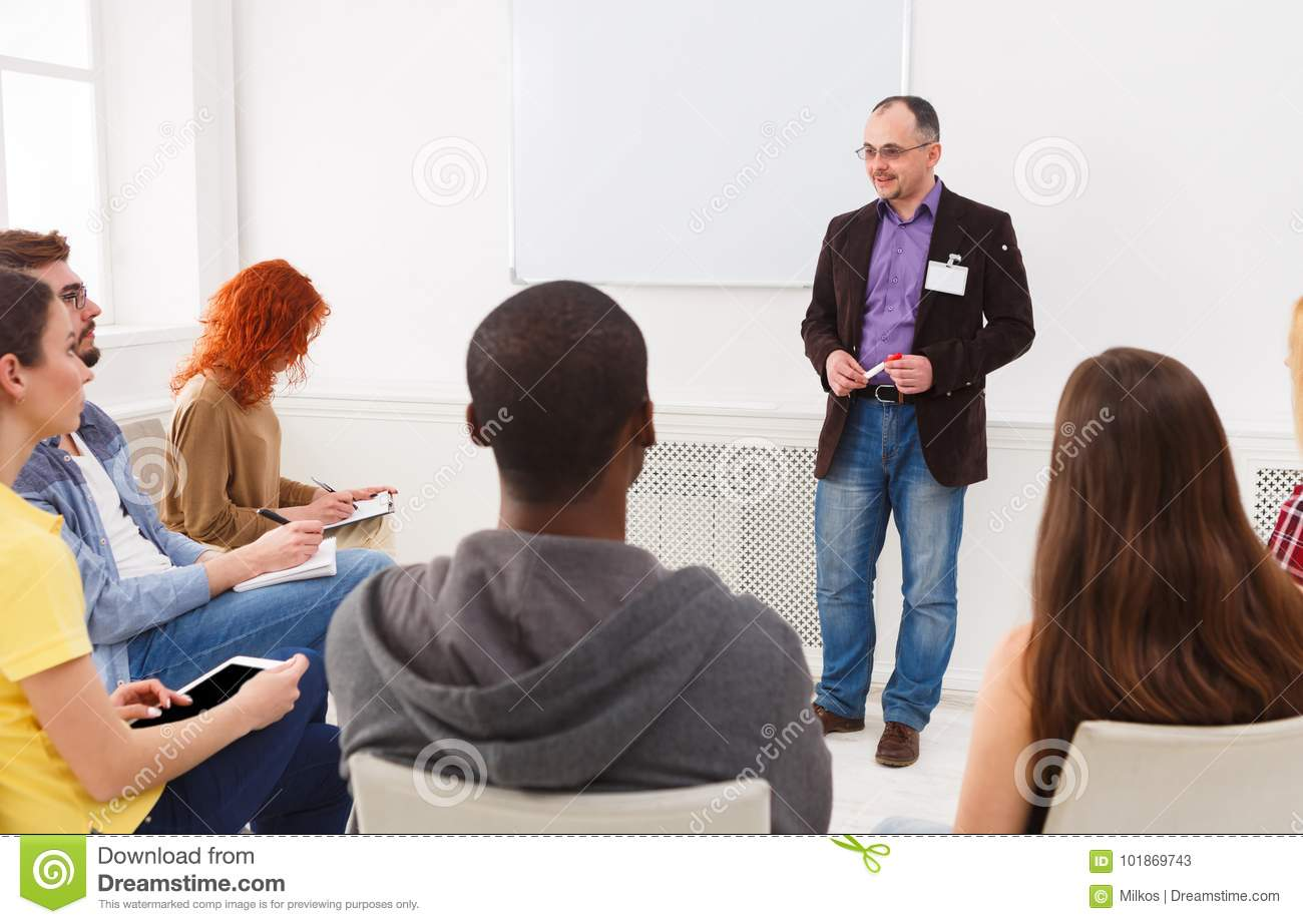 Adult man doing presentation in office copy space