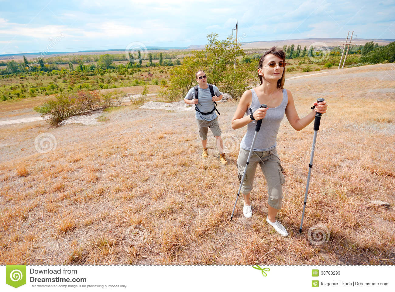 Adult man and woman are hiking