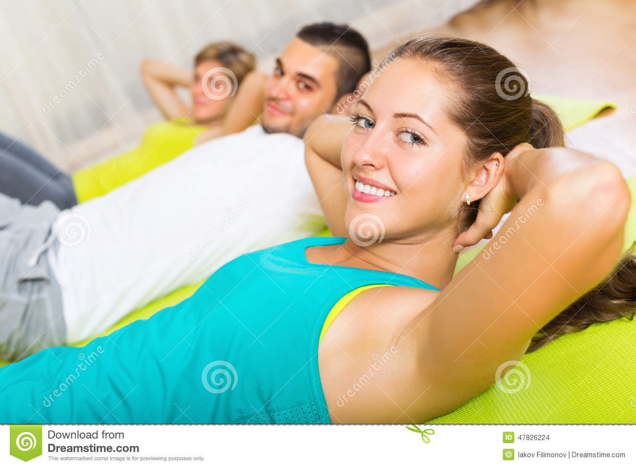 Adult people working in gym