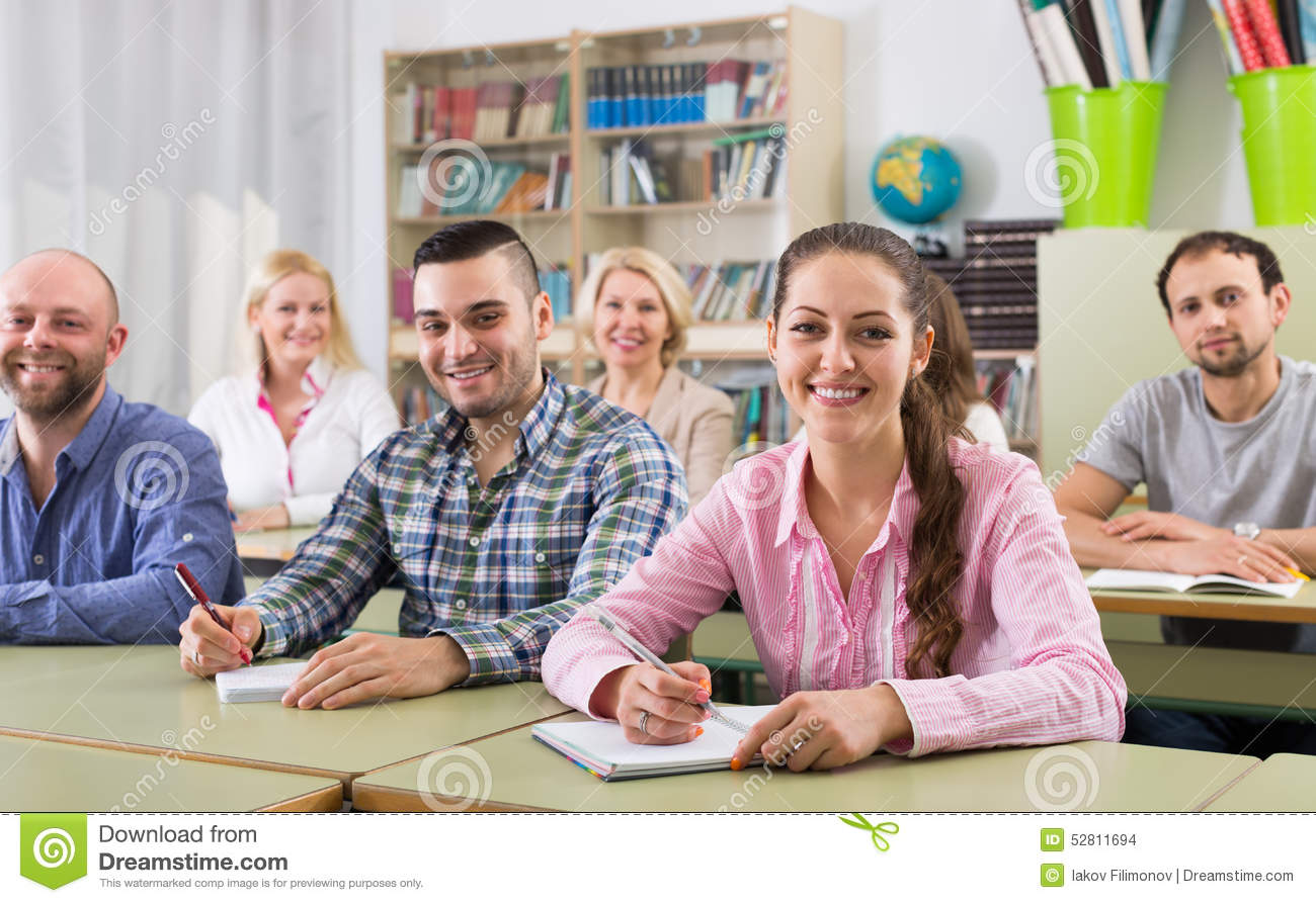 Adult students writing in classroom