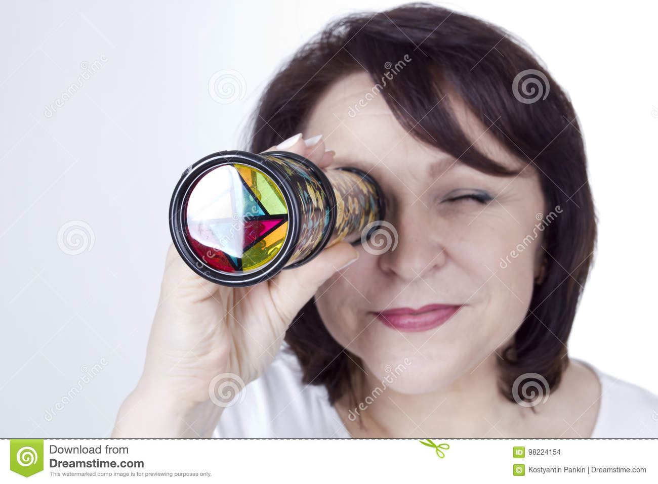 Adult woman looking into a kaleidoscope