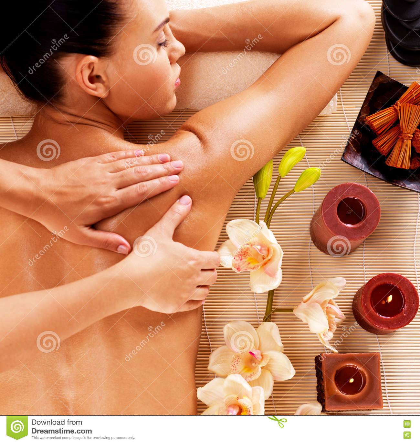 Adult woman in spa salon having body massage.