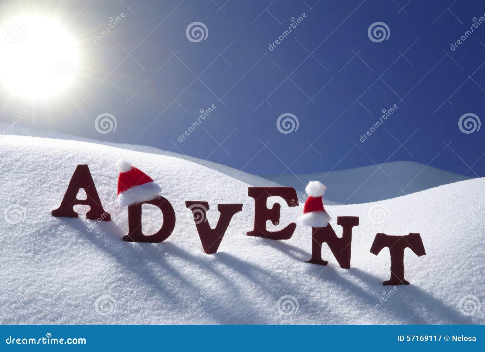 advent mean christmas time snow santa hat blue sky stock photo