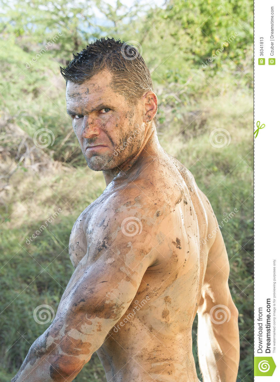 Portrait of handsome sweaty muddy athletic shirtless Caucasian man in ...