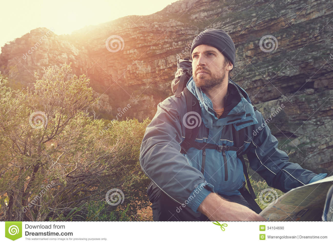 Portrait Of Adventure Man With Map And Extreme Explorer Gear On ...