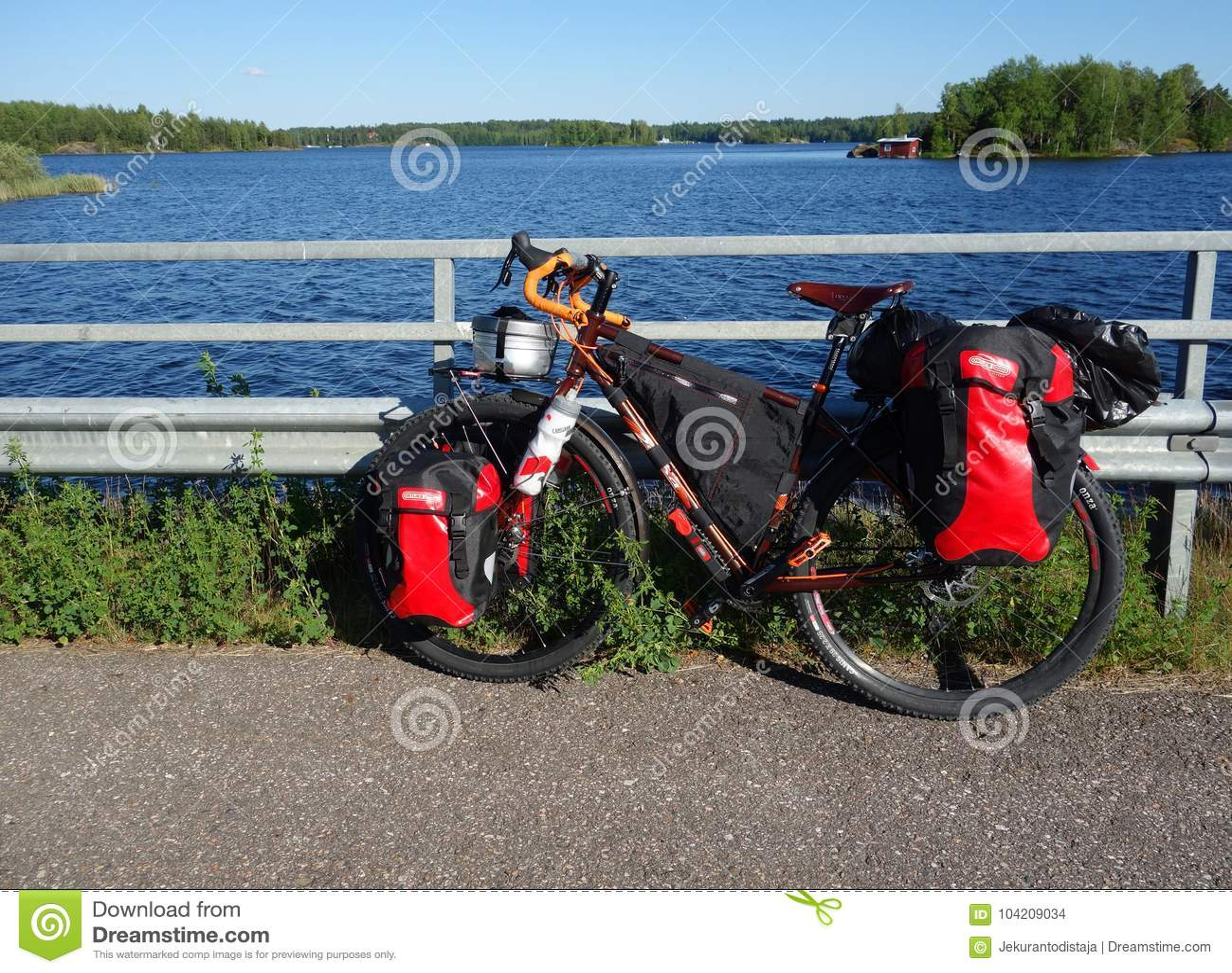 Adventure touring bike by lake Saimaa on summer evening
