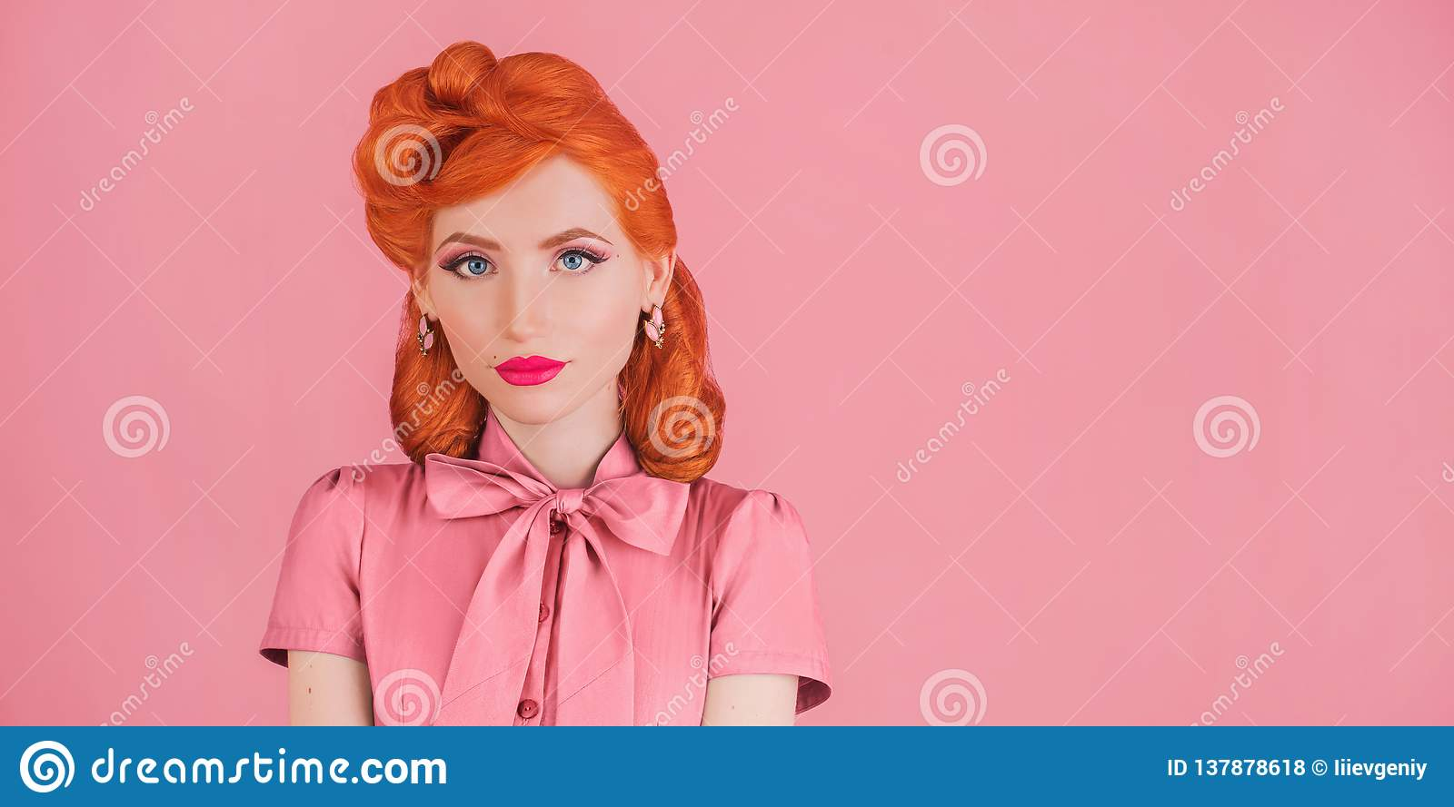 Advertise cosmetics. Woman smile with pink lipstick in retro dress. Minimal color trend in design. Redhead model with red lips