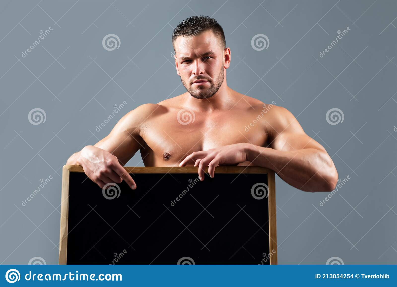 Bodybuilder With Blank White Poster Stock Photo - Download