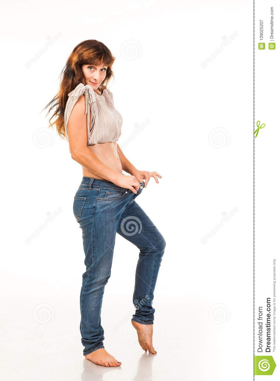 The Woman Pulls Back Her Jeans, Which Became Big  Stock