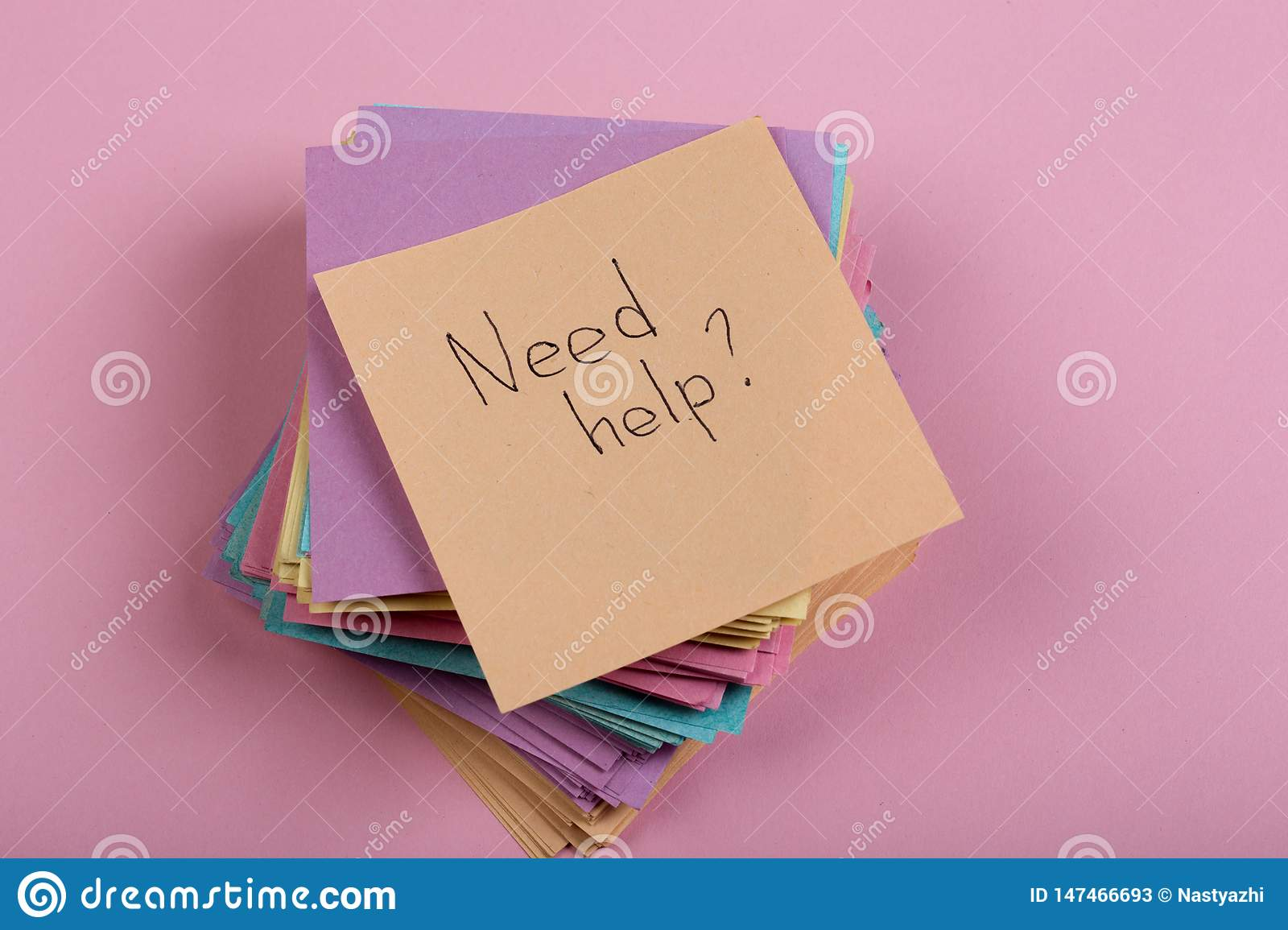"""Advice concept - Sticker with the words """"need help"""" on pink background. Concept of asking for help"""