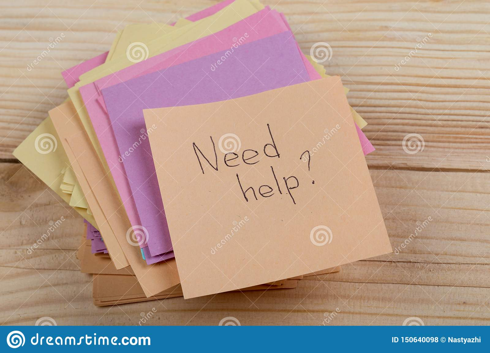 "Advice concept - Sticker with the words ""need help"" on wooden background. Concept of asking for help"
