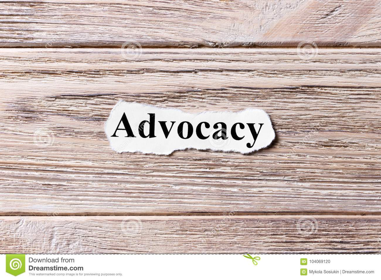 Advocacy of the word on paper. concept. Words of advocacy on a wooden background