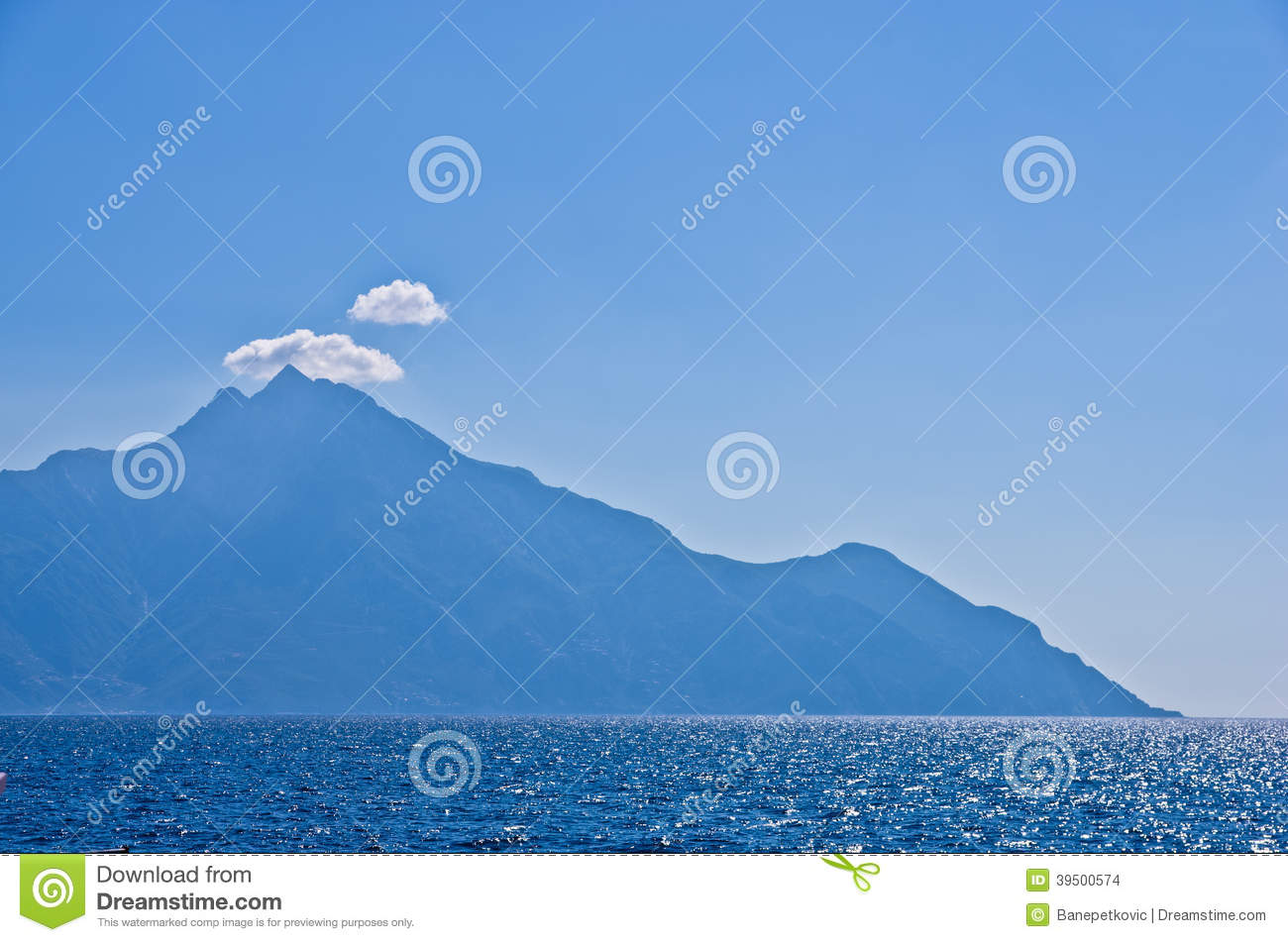 Aegean sea, silhouette of the holy mountains Athos and a small cloud above the mountain top