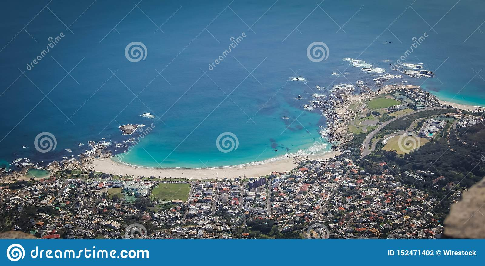 Aerial beautiful shot of the coast of Camps Bay, Cape Town, South Africa