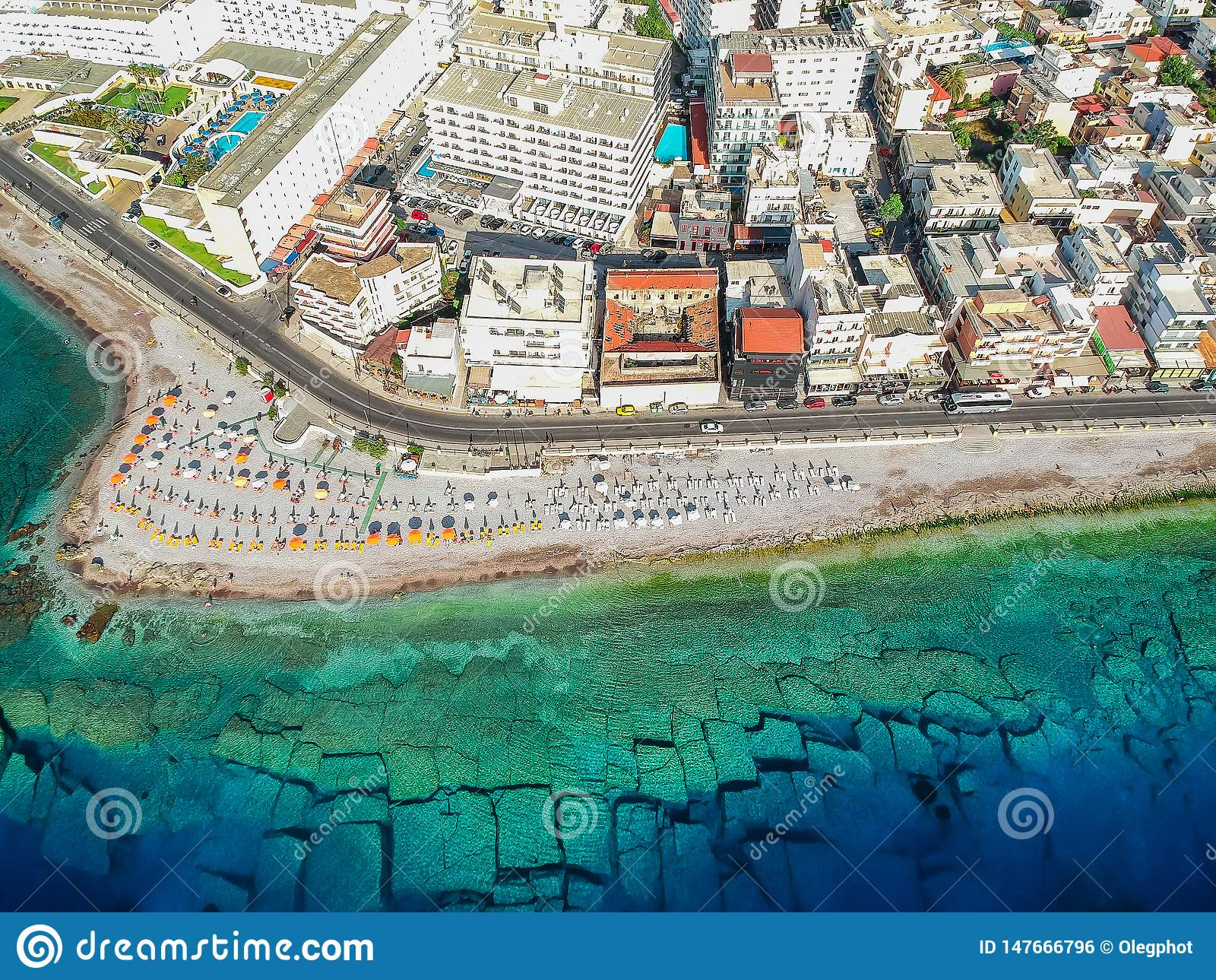 Aerial birds eye view drone photo of Elli beach on Rhodes city island, Dodecanese, Greece. Panorama with nice sand, lagoon and