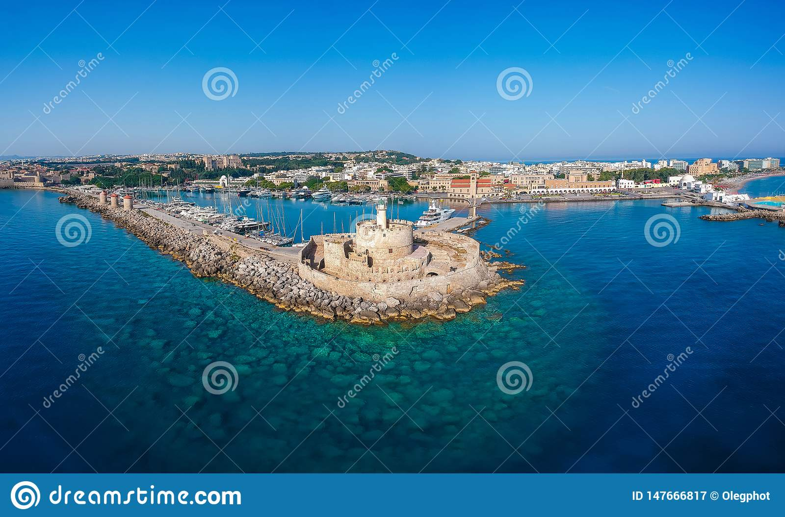 Aerial birds eye view drone photo of Rhodes city island, Dodecanese, Greece. Panorama with Mandraki port, lagoon and clear blue