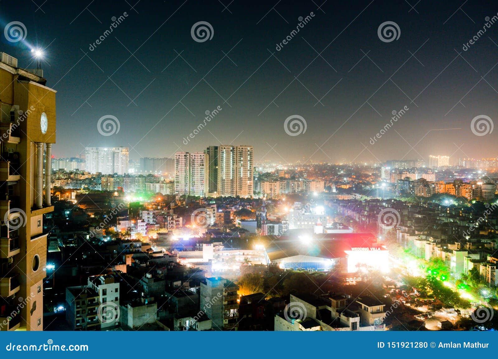 Aerial Cityscape Shot Of Noida, Delhi, Grugaon At Dusk