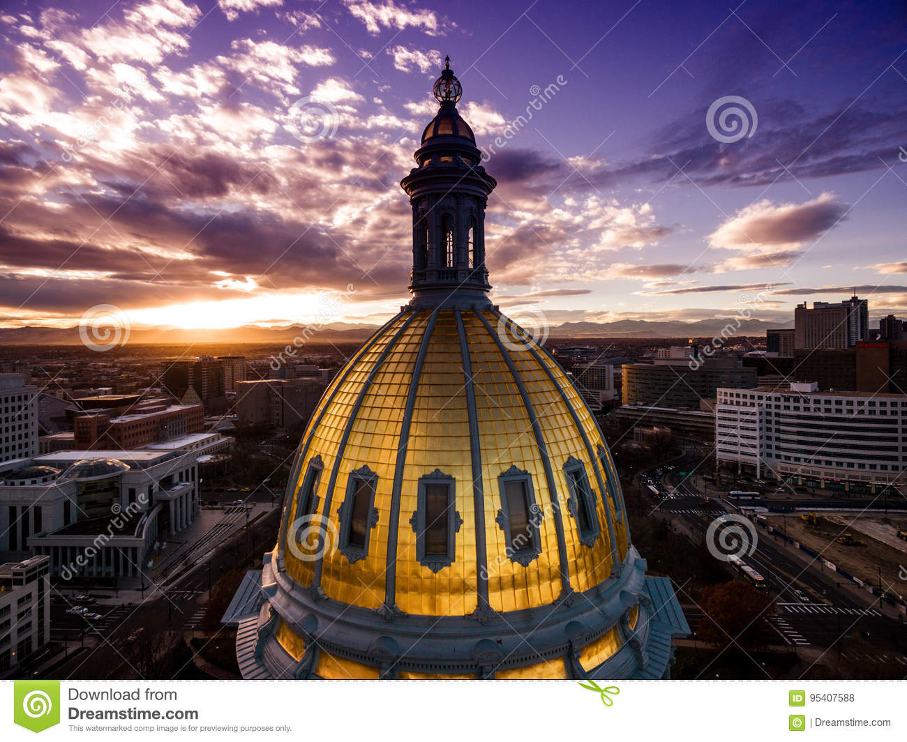 Aerial Drone Photograph - Stunning golden sunset over the Colorado state capital building & Rocky Mountains, Denver Colorado.