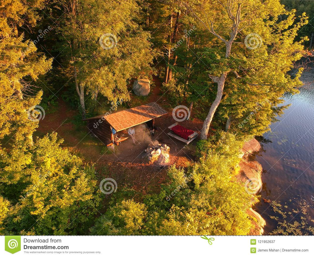 Aerial drone shot of lean to Campsite and campfire in the Adirondack Mountains