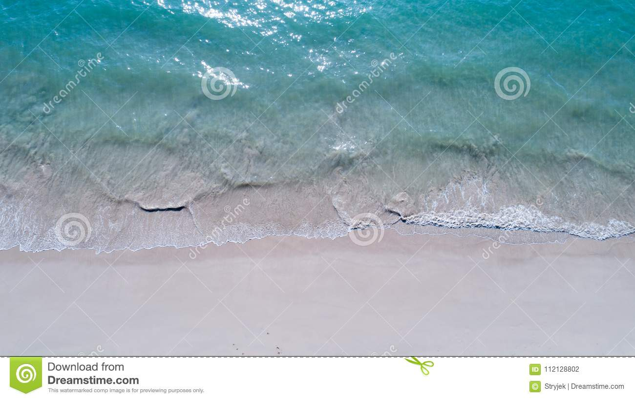 Aerial top view of empty sandy beach and sea