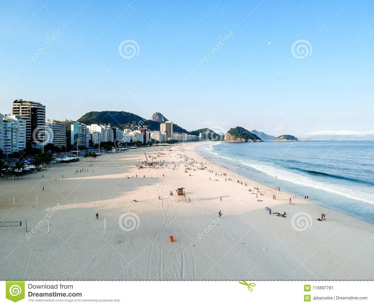 aerial drone view of Copacabana beachs during late afternoon,, some shadows can be seen on the sand. Rio de Janeiro, Brazil