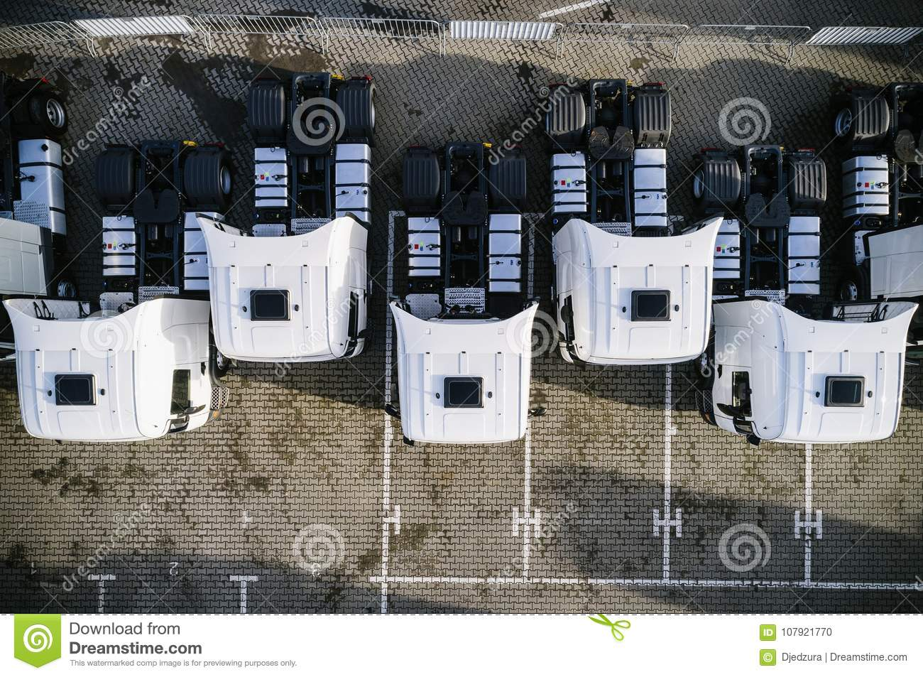 Aerial drone view of parked white trucks