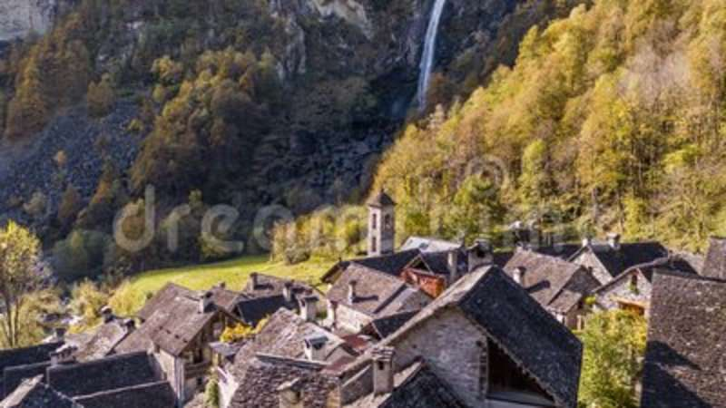 Waterfall Foroglio Village Rocks Ticino Switzerland Aerial 4k. Aerial footage from the beautifully located canton of Ticino in the south part of Switzerland stock video footage