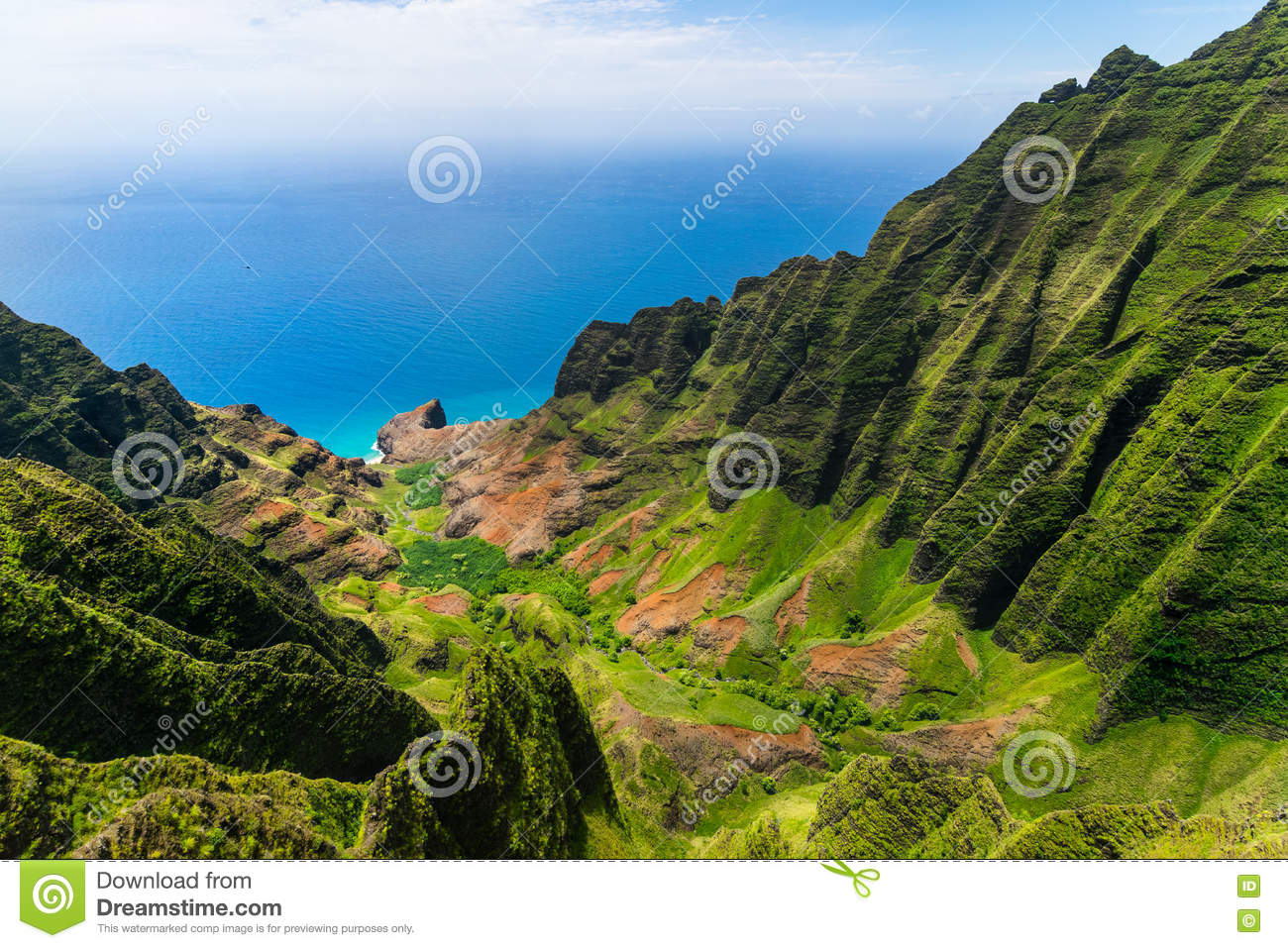 Aerial landscape view of cliffs and green valley, Kauai
