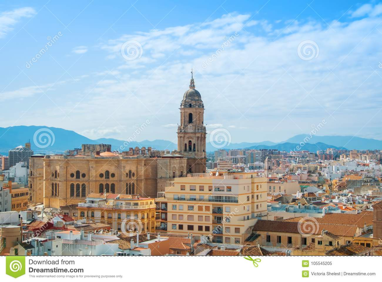 Aerial panoramic view over the roofs to a tower of Malaga Cathedral from the walls and towers of Castillo Gibralfaro (Castle of G