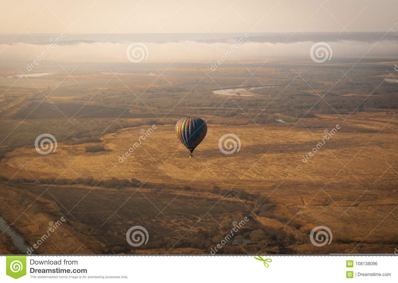 Aerial picture of aerostatic balloon above the field