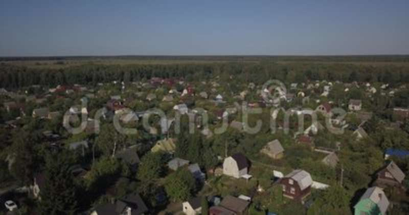 AERIAL SHOT: Beautiful small village or township 4k 4096 x 2160 pixels. AERIAL SHOT: Beautiful small village or township in the summer forest. A lot of houses stock video
