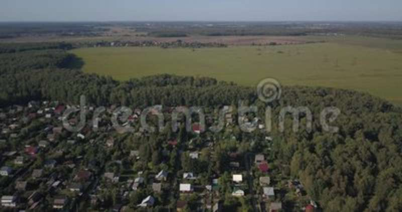 AERIAL SHOT: Beautiful small village or township 4k 4096 x 2160 pixels. AERIAL SHOT: Beautiful small village or township in the summer forest. A lot of houses stock footage