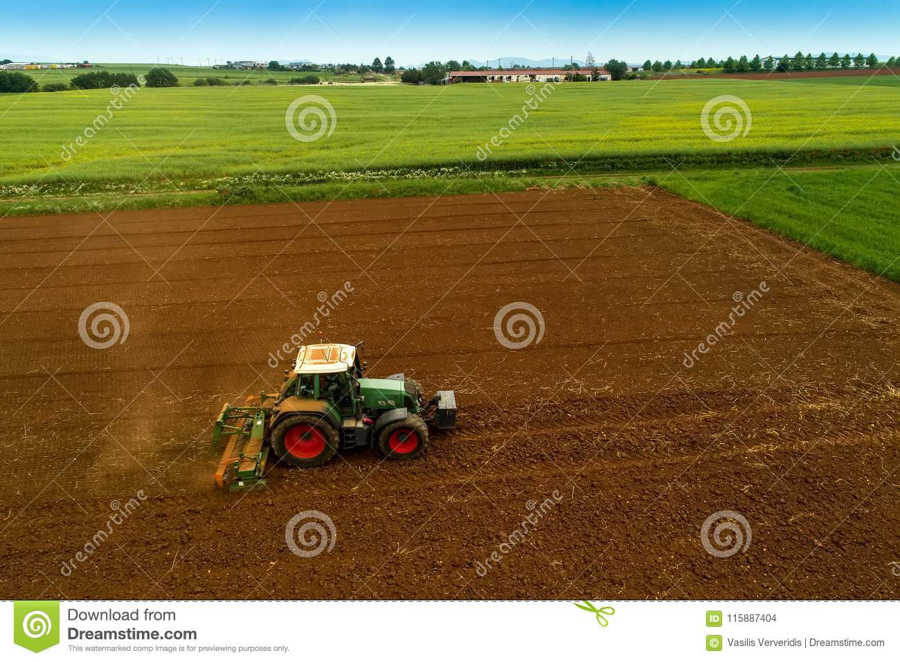 Aerial Shot Of Farmer With A Tractor On The Agricultural