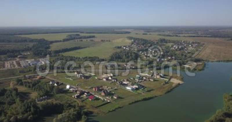 Aerial shot of houses in township on the river in Kiev 4k 4096 x 2160 pixels.  stock video footage