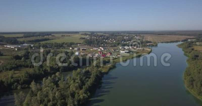 Aerial shot of houses in township on the river in Kiev 4k 4096 x 2160 pixels.  stock footage