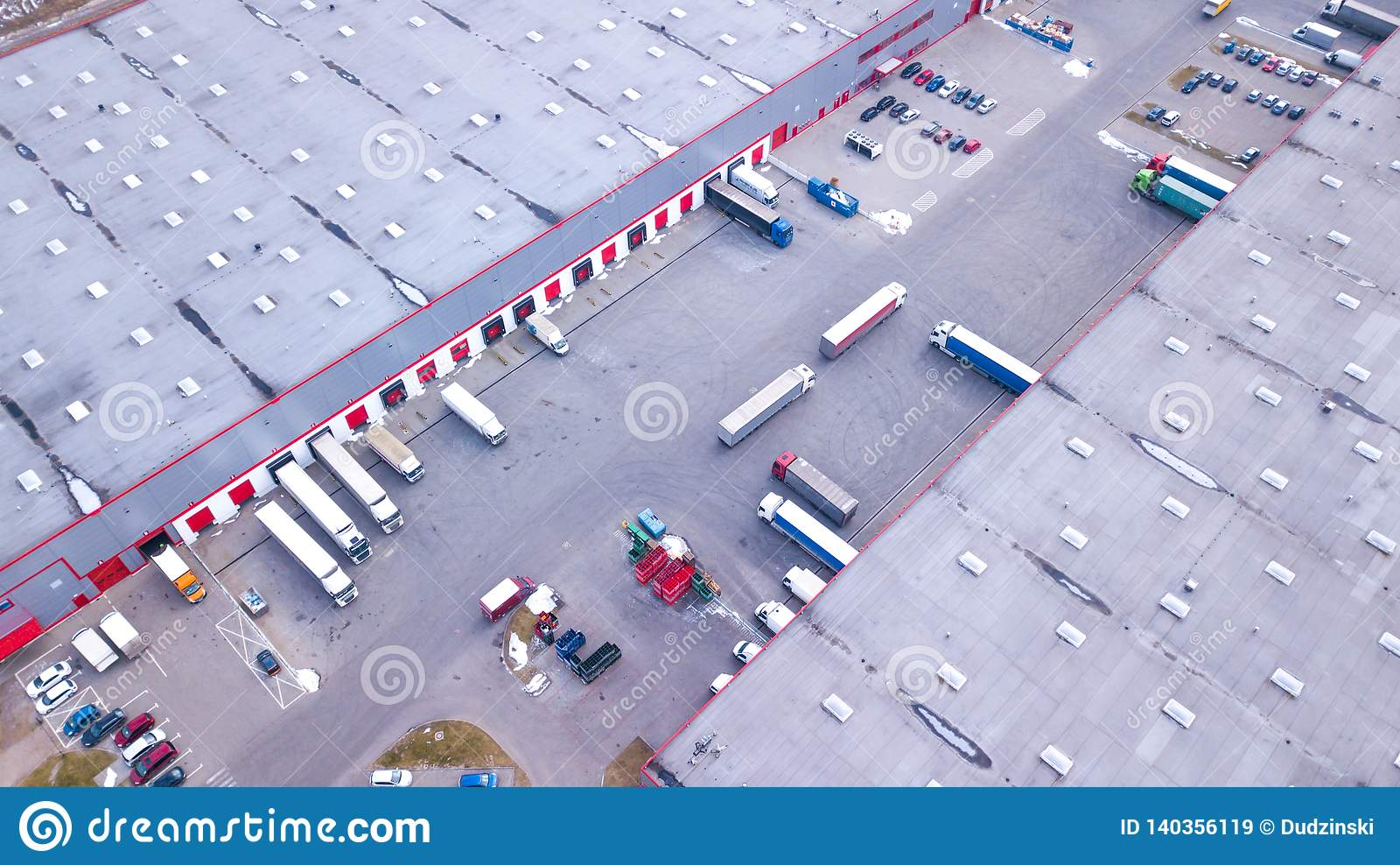 Aerial Shot Of Industrial Warehouse Loading Dock Where Many